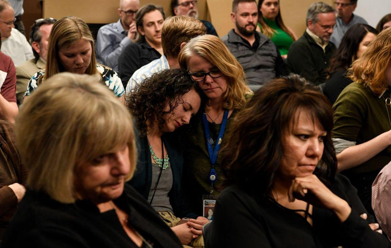 Journalists react to news of layoffs at the Denver Post on March 14, 2018. PHOTO: AARON ONTIVEROZ/THE DENVER POST/GETTY IMAGES