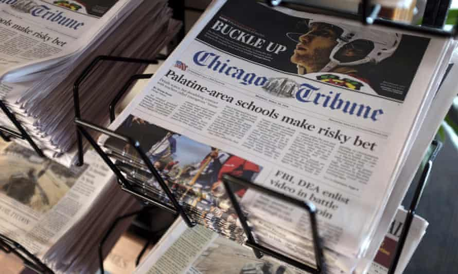 Chicago Tribune newspapers stacked in racks.