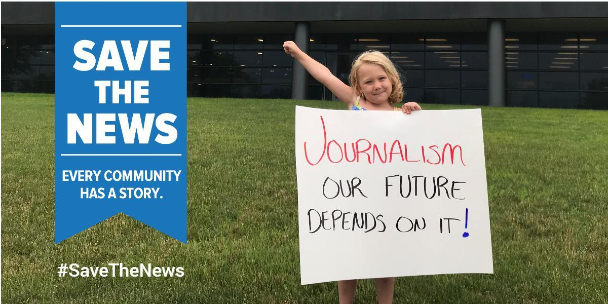 "Girl holding sign that says, ""Journalism, our future depends on it!"""